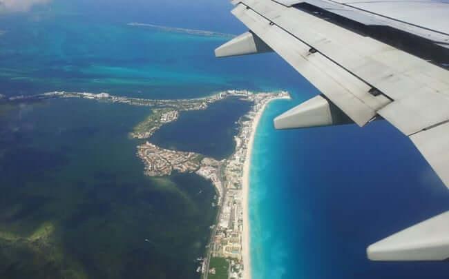 Tempo de avião até Cancún